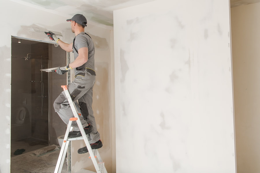 professional drywall expert during work